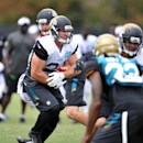 Jacksonville Jaguars' running back Toby Gerhart (21) rcarries the ball in practice Tuesday, Aug. 12, 2014, in Jacksonville, Fla. The NFL's Jacksonville Jaguars held last practice open to the public on Tuesday The Associated Press