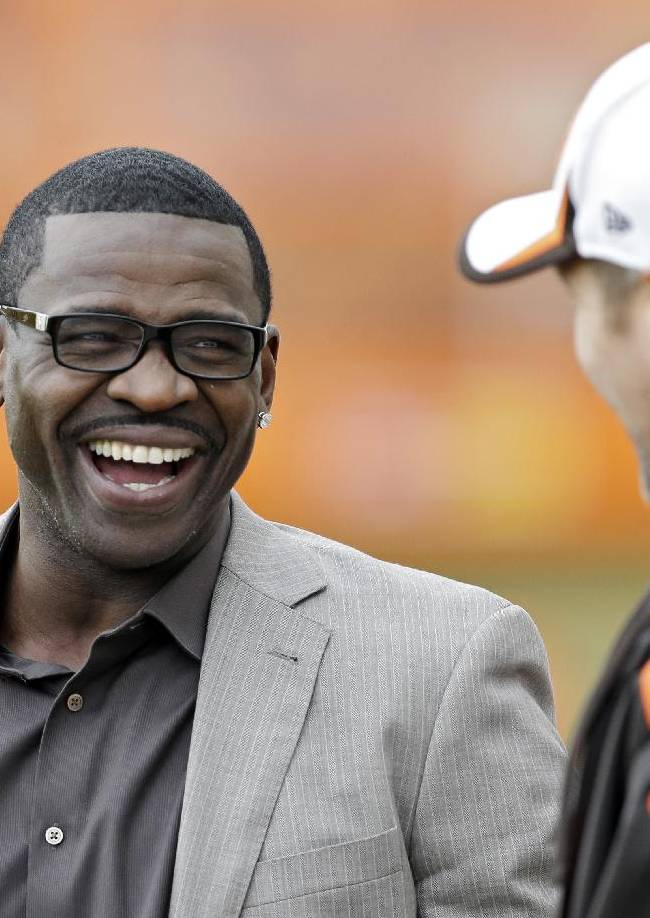 Hall of Fame receiver Michael Irvin, left, talks with Cleveland Browns director of player engagement Aaron Shea, during practice at the NFL football team's facility in Berea, Ohio Wednesday, Nov. 6, 2013. Irvin spoke to Browns' players before practice about the commitment it takes to win a Super Bowl