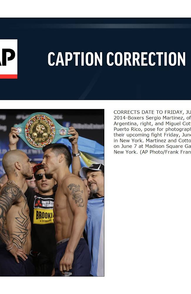 CORRECTS DATE TO FRIDAY, JUNE 6, 2014-Boxers Sergio Martinez, of Argentina, right, and Miguel Cotto, of Puerto Rico, pose for photographs before their upcoming fight Friday, June 6, 2014, in New York. Martinez and Cotto will fight on June 7 at Madison Square Garden in New York