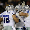 Dallas Cowboys tight end Gavin Escobar, second from right, celebrates a touchdown with his teammates during the second half of an NFL football game against the Chicago Bears Thursday, Dec. 4, 2014, in Chicago The Associated Press