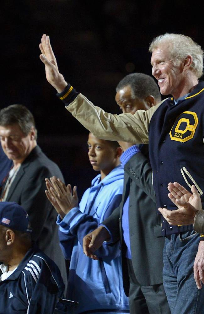 Former UCLA center Bill Walton waves as he stands with surviving members of the 1972-1973 NCAA championship team during a ceremony to honor them during halftime of and NCAA college basketball game between UCLA and Oregon State, Sunday, March 2, 2014, in Los Angeles. UCLA won 74-69