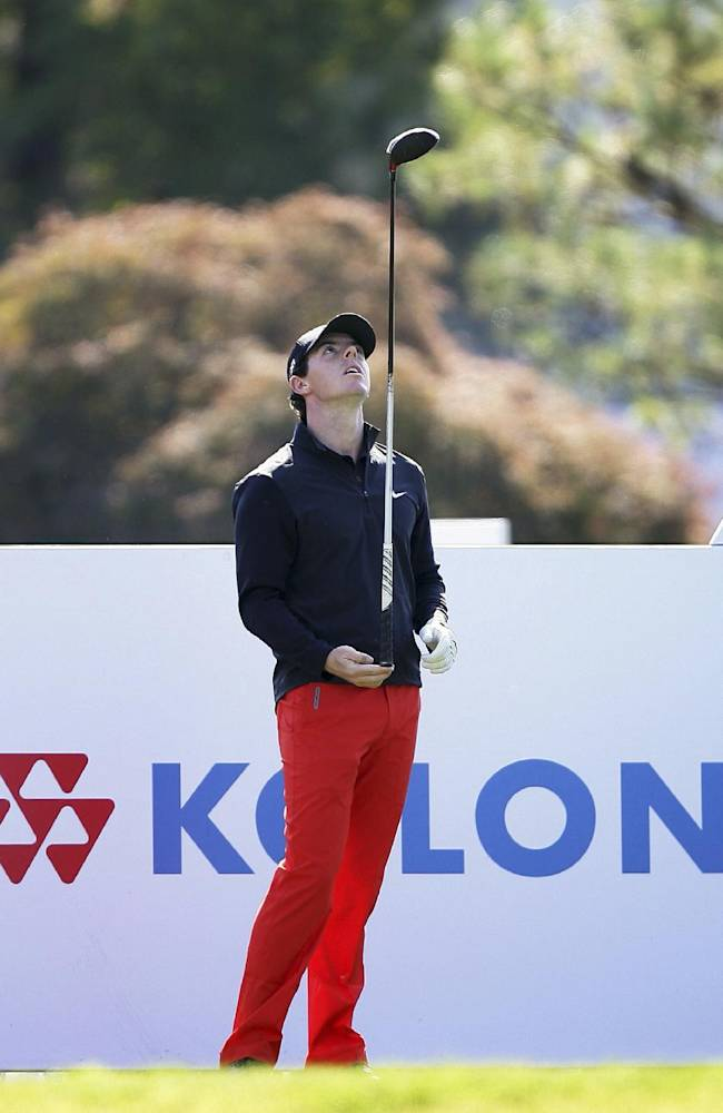 Rory McIlroy of Northern Ireland plays with his club during the final round of the Korea Open golf tournament at Woo Jeong Hills Country Club in Cheonan, South Korea, Sunday, Oct. 20, 2013