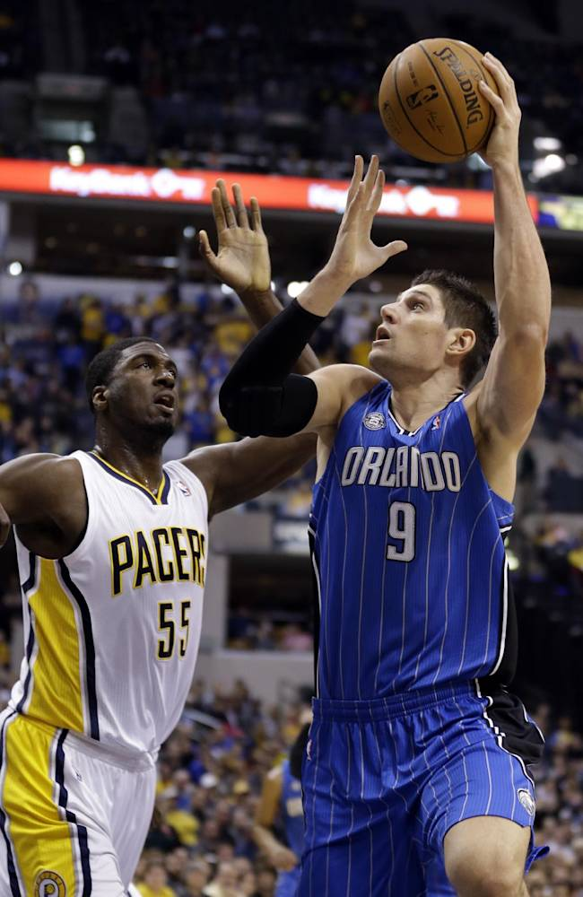 Orlando Magic center Nikola Vucevic, right, shoots over Roy Hibbert in the first half of an NBA basketball game in Indianapolis, Monday, Feb. 3, 2014