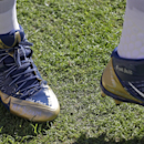 In this Dec. 7, 2014, file photo, Mike Brown and Travon Martin's names are among several written on St. Louis Rams wide receiver Kenny Britt's (81) shoes as he walks across the field during the first half of an NFL football game against the Washington Red