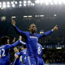 Chelsea's Didier Drogba, right, celebrates scoring his side's second goal during the English Premier League soccer match between Chelsea and Tottenham Hotspur at Stamford Bridge stadium in London, Wednesday, Dec. 3, 2014. (AP Photo/Matt Dunham)