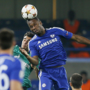 Schalke's Kaan Ayhan, left, and Chelsea's Didier Drogba go for a header during the Champions League group G soccer match between Chelsea and Schalke 04 at Stamford Bridge stadium in London, Wednesday, Sept. 17, 2014