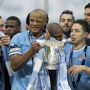 Manchester City players including captain Vincent Kompany, center left, celebrate after their 3-1 win against Sunderland in the League Cup Final at Wembley Stadium, London, England, Sunday March 2, 2014
