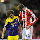 Stoke's Peter Crouch, right, comforts Swansea's Jose Alberto Canas after a facial injury during the English Premier League soccer match between Stoke City and Swansea City at Britannia Stadium in Stoke on Trent, England, Wednesday, Feb. 12, 2014