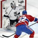 Los Angeles Kings goalie Martin Jones (31) makes the save against Montreal Canadiens left wing Travis Moen during the first period of an NHL hockey game in Montreal on Tuesday, Dec. 10, 2013. (AP Photo/The Canadian Press, Ryan Remiorz)