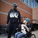 In this Oct. 18, 2013 photo, Philadelphia eagles quarterback Michael Vick talks with seven-year-old Justin Perales during a tour of the Eagles training facility in Philadelphia. Four years after his release from prison, Vick is one of the NFL's most activ