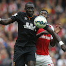Hull City's Mohamed Diame, left, shields the ball from Arsenal's Danny Welbeck during the English Premier League soccer match between Arsenal and Hull City at the Emirates stadium in London Saturday Oct. 18, 2014