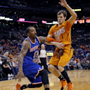New York Knicks' J.R. Smith, left, drives against Phoenix Suns' Goran Dragic, of Slovenia, during the first half of an NBA basketball game, Friday, March 28, 2014, in Phoenix The Associated Press