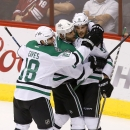 Dallas Stars' Tyler Seguin (91) celebrates his first goal against the Arizona Coyotes with teammates Patrick Eaves (18) and Trevor Daley (6) during the second period of an NHL hockey game Tuesday, Nov. 11, 2014, in Glendale, Ariz The Associated Press