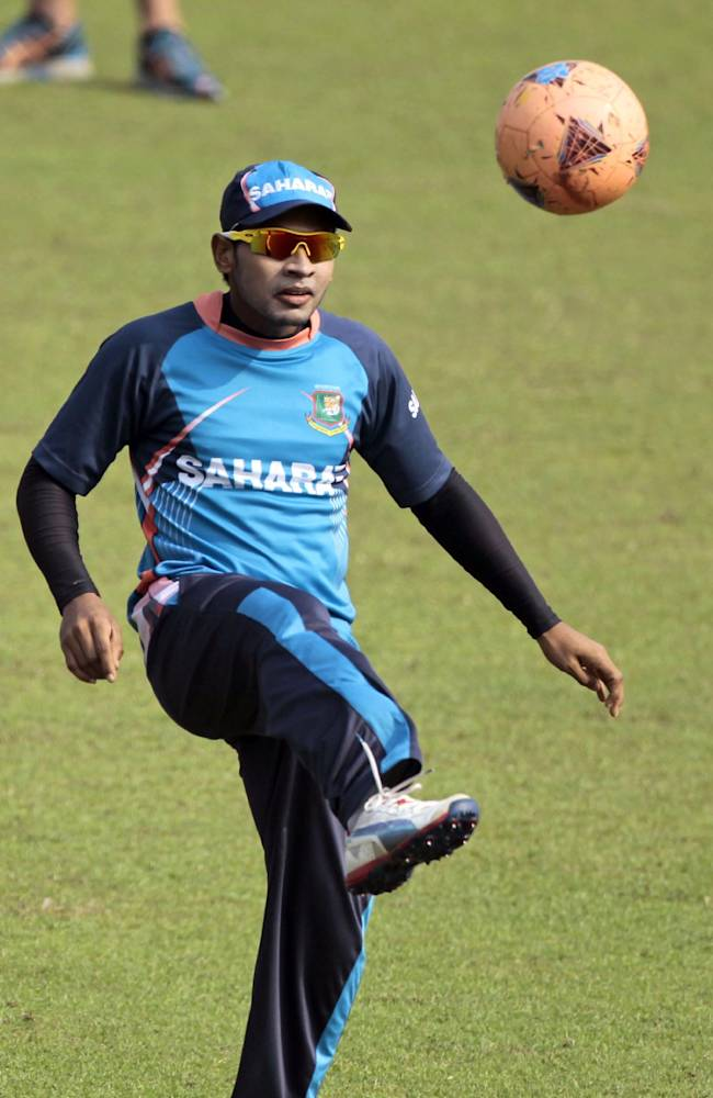 Bangladeshi cricket captain Mushfiqur Rahim plays with a soccer ball during a practice session a day ahead of their third one-day international cricket match against New Zealand in Dhaka, Bangladesh, Saturday, Nov. 2, 2013