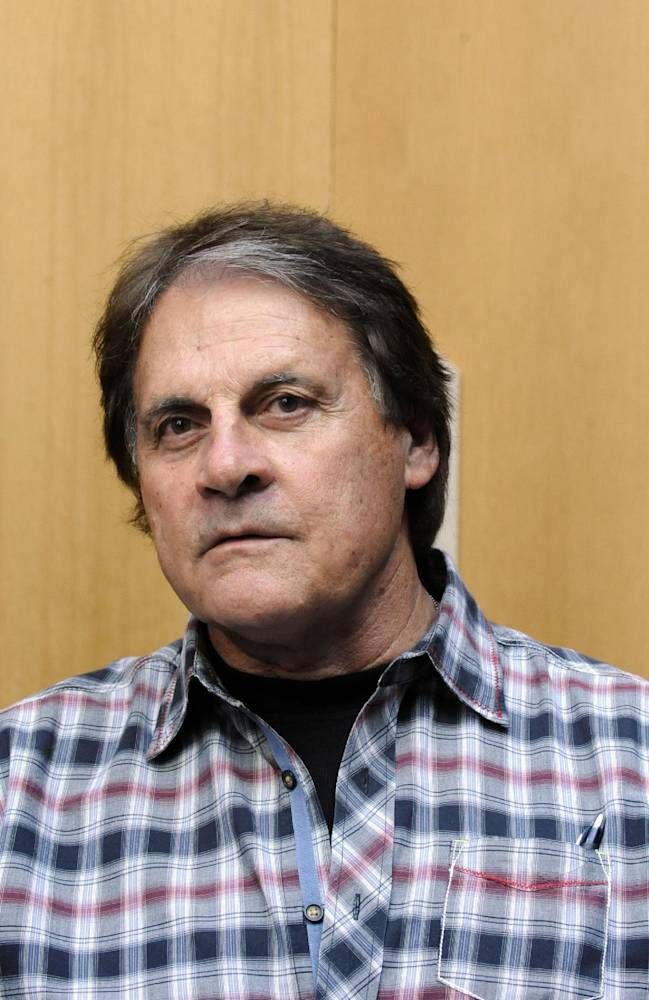 Baseball Hall of Fame inductee Tony La Russa speaks with reporters at the National Baseball Hall of Fame and Museum in Cooperstown, N.Y., Thursday, April 10, 2014. La Russa is scheduled to be inducted into the hall this summer