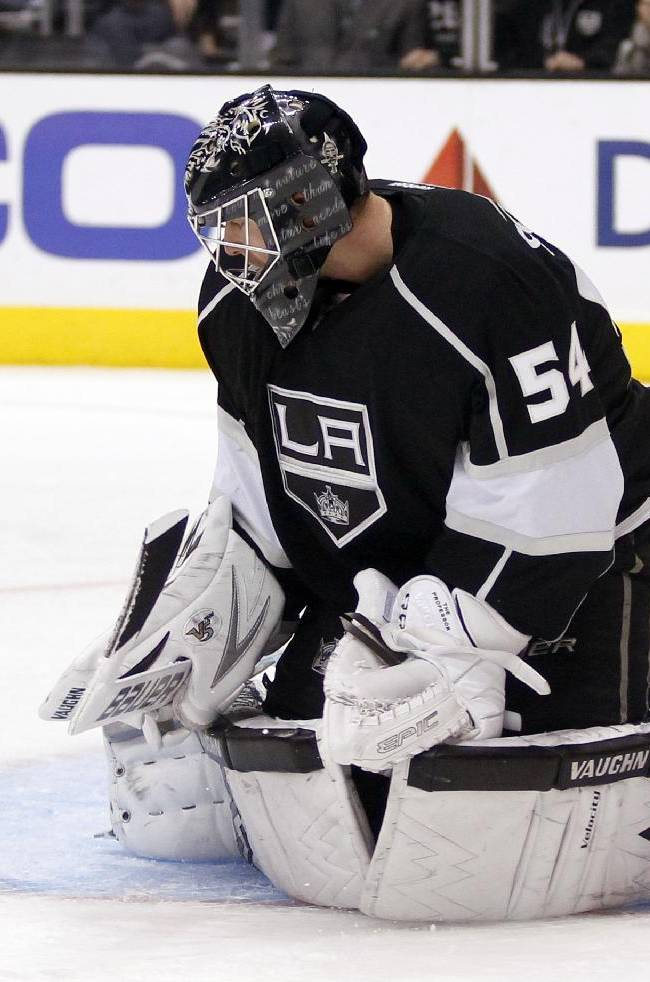 Los Angeles Kings goalie Ben Scrivens (54) blocks a shot from the Tampa Bay Lightning in the third period of an NHL hockey game Tuesday, Nov. 19, 2013, in Los Angeles. The Kings won 5-2