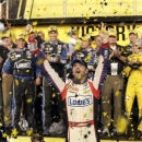 Jimmie Johnson celebrates in victory lane after winning the NASCAR All-Star auto race at Charlotte Motor Speedway in Concord, N.C., Satday, May 18, 2013. (AP Photo/Chuck Burton)