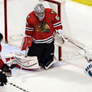 Chicago Blackhawks goalie Corey Crawford (50) blocks a shot by San Jose Sharks left wing Patrick Marleau (12) as defenseman Duncan Keith (2) watches during the third period of an NHL hockey game in Chicago, Sunday, Nov. 9, 2014. The Blackhawks won 5-2 The