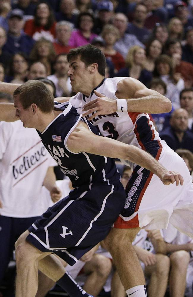 Gonzaga's Drew Barham (43) and BYU's Josh Sharp fight for a loose ball during the second half of an NCAA college basketball game, on Saturday, Jan. 25, 2014, in Spokane, Wash. Gonzaga won 84-69