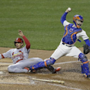 St. Louis Cardinals' Jon Jay (19) slides into New York Mets catcher Travis d'Arnaud after being tagged out at home plate during the fourth inning of a baseball game Tuesday, April 22, 2014, in New York The Associated Press