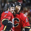 Calgary Flames' Dennis Wideman, right, celebrates his goal with teammate Kris Russell during the first period of an NHL hockey game against the Washington Capitals on Saturday, Oct. 25, 2014, in Calgary, Alberta The Associated Press