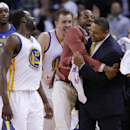 Golden State Warriors head coach Mark Jackson, right, is hugged by Andre Iguodala, in pink, after a 130-120 win over the Minnesota Timberwolves during the second half of an NBA basketball game on Monday, April 14, 2014, in Oakland, Calif The Associated Pr