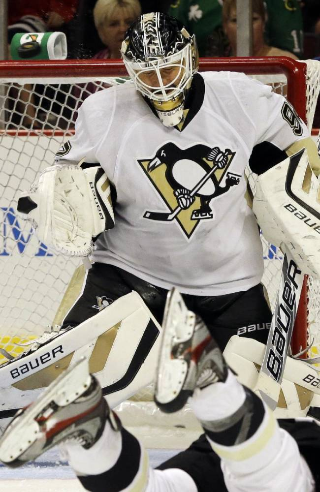 Pittsburgh Penguins goalie Tomas Vokoun blocks a shot by Chicago Blackhawks' Patrick Kane during the second period of an NHL preseason hockey game in Chicago, Thursday, Sept. 19, 2013