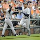 New York Yankees' Derek Jeter runs towards home to score on an RBI double by Jacoby Ellsbury during the seventh inning of a baseball game against the Baltimore Orioles, Saturday, July 12, 2014, in Baltimore. The Yankees won 3-0. (AP Photo/Nick Wass)