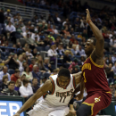 Milwaukee Bucks' Brandon Knight (11) drives against Cleveland Cavaliers' Dion Waiters during the second half of an NBA basketball game Friday, April 11, 2014, in Milwaukee The Associated Press
