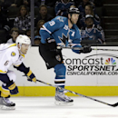 San Jose Sharks' Joe Thornton, right, scores an empty net goal against Nashville Predators' Shea Weber (6) during the third period of an NHL hockey game Saturday, Dec. 13, 2014, in San Jose, Calif. The Sharks won, 2-0 The Associated Press