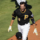 Pittsburgh Pirates' Neil Walker (18) is greeted by teammates after hitting a walkoff solo-home run off Chicago Cubs relief pitcher Carlos Villanueva during the tenth inning of a baseball game in Pittsburgh, Monday, March 31, 2014. The Pirates won 1-0 in t