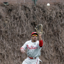 Philadelphia Phillies center fielder Ben Revere catches a sacrifice fly ball hit by Chicago Cubs' Ryan Sweeney during the first inning of a baseball game in Chicago, Sunday, April 6, 2014 The Associated Press