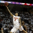 Florida's Mike Rosario (3) shoots as Texas A&M's Kourtney Roberson defends during the first half of an NCAA college basketball game on Thursday, Jan. 17, 2013, in College Station, Texas. (AP Photo/David J. Phillip)