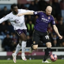 West Ham United's James Collins, right vies for the ball with Everton's Romelu Lukaku during their English FA Cup third round replay soccer match between West Ham United and Everton at the Boleyn Ground stadium in London, Tuesday, Jan. 13, 2015