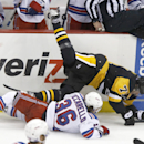 Pittsburgh Penguins' Evgeni Malkin (71) hits the ice after being checked by New York Rangers' Mats Zuccarello (36) in the third period of an NHL hockey game, Saturday, Nov. 15, 2014, in Pittsburgh. The Penguins won 3-2 in a shootout The Associated Press