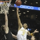 La Salle's Tyreek Duren goes up past Butller's Andrew Smith, left, and Kellen Dunham during the first half of an NCAA college basketball game at the Atlantic 10 Conference tournament, Friday, March 15, 2013, in New York. (AP Photo/Mary Altaffer)