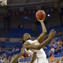 Florida's DeVon Walker (25) shoots against Savannah State forward Rashad Hassan (22) during the second half of an NCAA college basketball game, Tuesday, Nov. 20, 2012, in Gainesville, Fla. Florida won 58-40. (AP Photo/Phil Sandlin)
