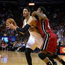 MIAMI, FL - DECEMBER 17:  Enes Kanter #0 of the Utah Jazz drives on Udonis Haslem #40 of the Miami Heat during a game  at American Airlines Arena on December 17, 2014 in Miami, Florida. NOTE TO USER: User expressly acknowledges and agrees that, by downloading and/or using this photograph, user is consenting to the terms and conditions of the Getty Images License Agreement. Mandatory copyright notice:  (Photo by Mike Ehrmann/Getty Images)