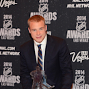 In this photo provided by the Las Vegas News Bureau, Dustin Brown of the Los Angeles Kings poses with the Mark Messier NHL Leadership Award for the player who exemplifies great leadership qualities to his team at the 2014 NHL Awards at Wynn Las Vegas. Tue