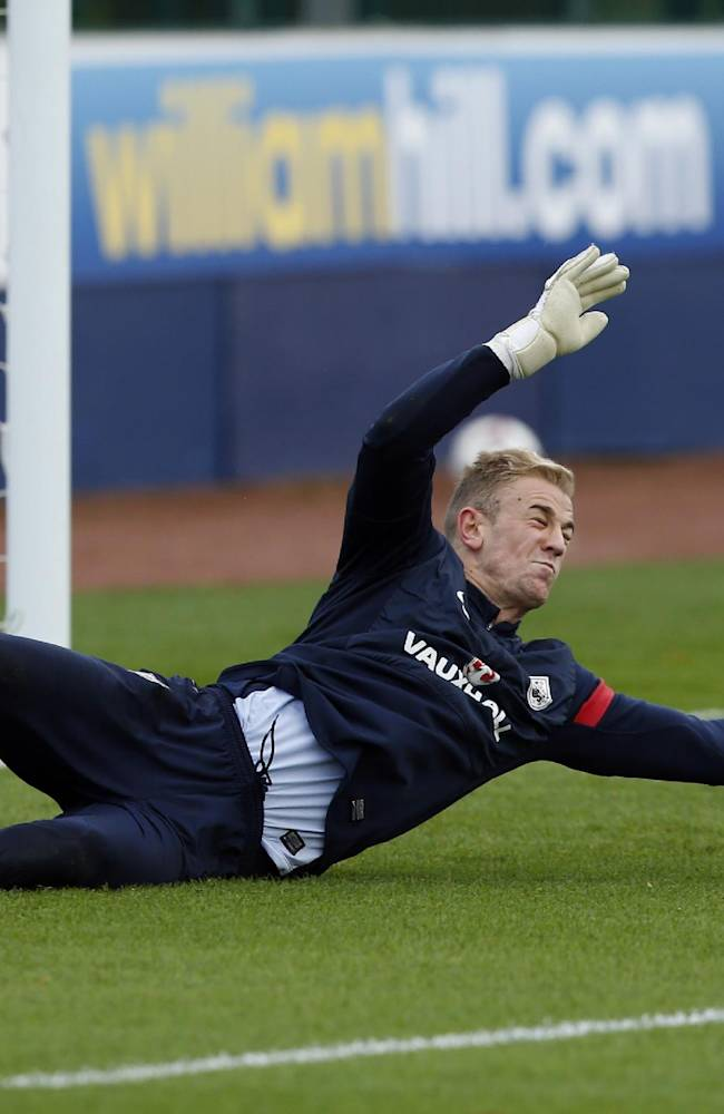 England goalkeeper Joe Hart makes a save during a training session at facilities in London Colney, Monday, Oct. 14, 2013.  England will play Poland in a World Cup Group H qualification soccer match at Wembley stadium in London on Tuesday