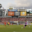 Liverpool goalkeeper Brad Jones and Manchester City's Edin Dzeko, right, fight for control of the ball in the first half of a Guinness International Champions Cup soccer tournament match Wednesday, July 30, 2014, in New York