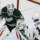 Minnesota Wild goalie Ilya Bryzgalov (30), of Russia, deflects a shot by Pittsburgh Penguins left wing Chris Kunitz (14) during the first period of an NHL hockey game in St. Paul, Minn., Saturday, April 5, 2014 The Associated Press