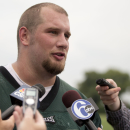 FILE - In this June 9, 2014 file photo, Philadelphia Eagles offensive tackle Lane Johnson speaks with member of the media after an NFL football organized team activity in Philadelphia. Johnson has been suspended for the first four games of the season for violating the NFL's performance-enhancing drugs policy. The fourth pick in the 2013 draft will be eligible to return to the Eagles' active roster Sept. 29. (AP Photo/Matt Rourke, File)