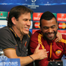 Roma manager Rudi Garcia, left, reacts with Ashley Cole, during a press conference at the Etihad Stadium, in Manchester, England, Monday, Sept. 29, 2014. Roma will be playing Manchester City in a Champions League Group E soccer match on Tuesday