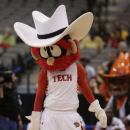 The Texas Tech mascot stands on the court during the first half of an NCAA college basketball game in the Big 12 women's tournament Saturday March 9, 2013, in Dallas. (AP Photo/LM Otero)