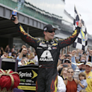 Jeff Gordon celebrates after winning the NASCAR Brickyard 400 auto race at Indianapolis Motor Speedway in Indianapolis, Sunday, July 27, 2014. (AP Photo/Darron Cummings)