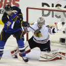 Chicago Blackhawks' goalie Corey Crawford, right, makes a glove-save against St. Louis Blues' David Backes (42) during the second period in Game 2 of a first-round NHL hockey playoff series on Saturday, April 19, 2014, in St. Louis The Associated Press