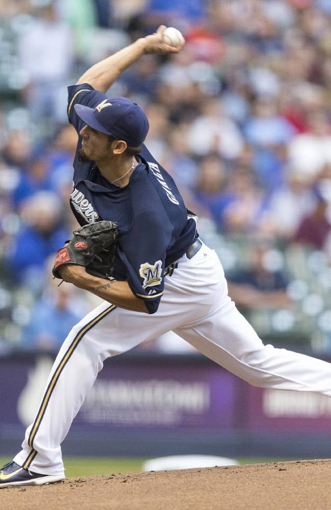 Garza rebounds from poor outing, Brewers win 9-1