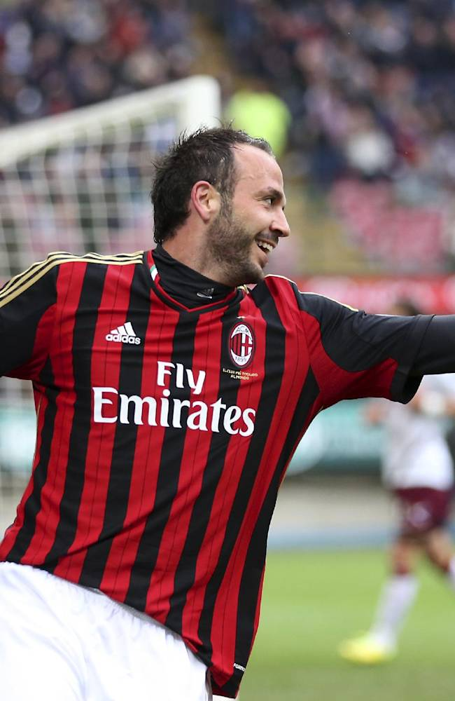 AC Milan forward Giampaolo Pazzini celebrates after scoring during the Serie A soccer match between AC Milan and Livorno at the San Siro stadium in Milan, Italy, Saturday, April 19, 2014
