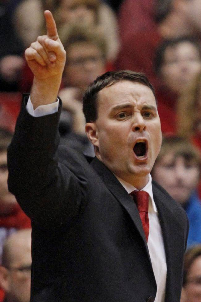 This  Dec. 22, 2013 file photo shows Dayton coach Archie Miller shouting to his team during an NCAA college basketball game in Dayton, Ohio. Dayton will host the NCAA First Four games this season and the NCAA has ruled that if Dayton is ruled eligible to be one of the First Four teams that they would be allowed to play on their home court